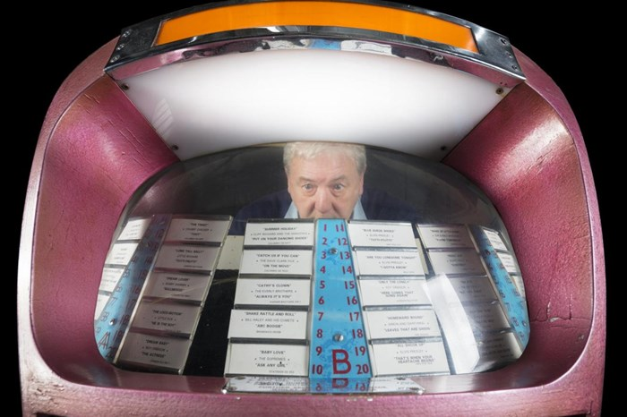 Curator Alan Mills and selected tracks on the jukebox