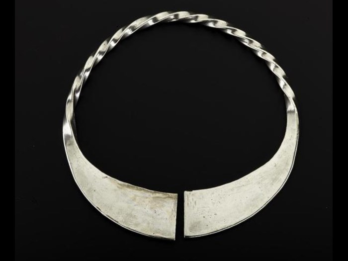 Silver penannular brooch, pin missing, with plain terminals and twisted hoop, from Norrie's Law, Fife, 350-550 AD.