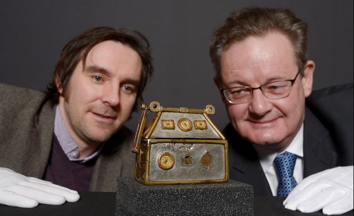 Dr Martin Goldberg, archaeology curator at National Museums Scotland and Hamish Torrie, Corporate Social Responsibility Director at The Glenmorangie Company, , with one of the National Museum's most treasured objects, the Monymusk Reliquary