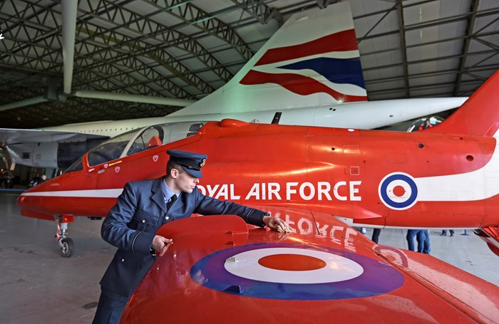 Above: Flight Officer Scott Bagshaw from the RAF helps to get the Red Arrow Hawk T1A ready for display to the public.