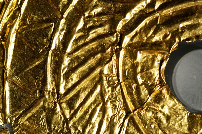 Detail of the most complete disc showing the scribed decoration and creasing of the gold. Photo: Barbara Armbruster.