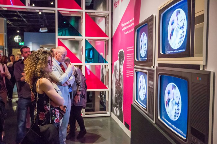 Visitors enjoy Rip It Up: The Story of Scottish Pop, the summer exhibition  at the National Museum of Scotland. Image by Chris Scott.
