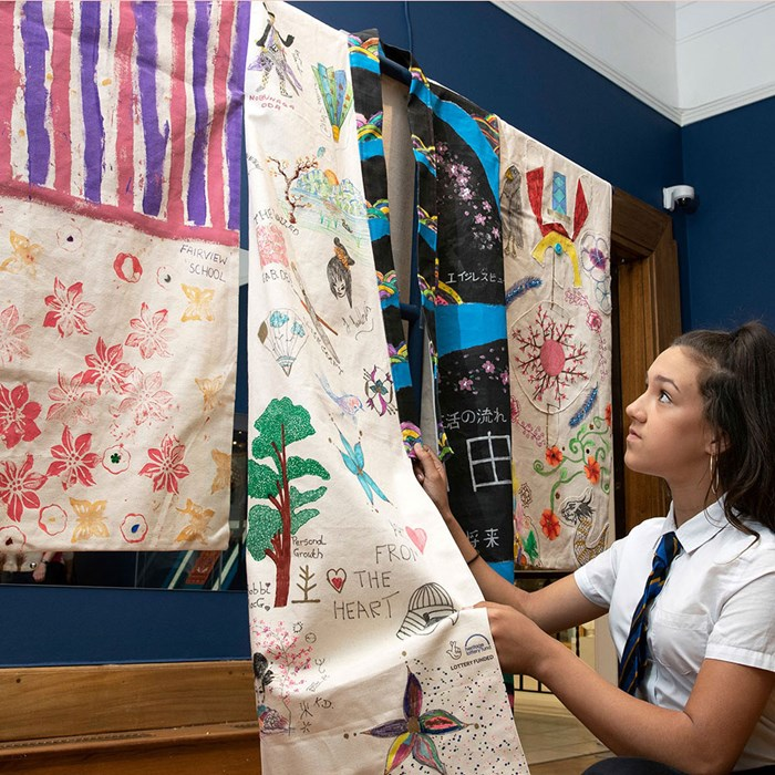 A pupil from Perth High School displays the community robe she helped to create as part of the exhibition, Dress to Impress at Perth Museum and Art Gallery. © Perthshire Picture Agency.