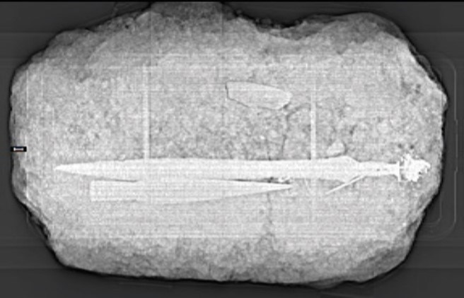 X-ray of the Carnoustie metalwork deposit after it was lifted intact in a soil block, and before it was excavated