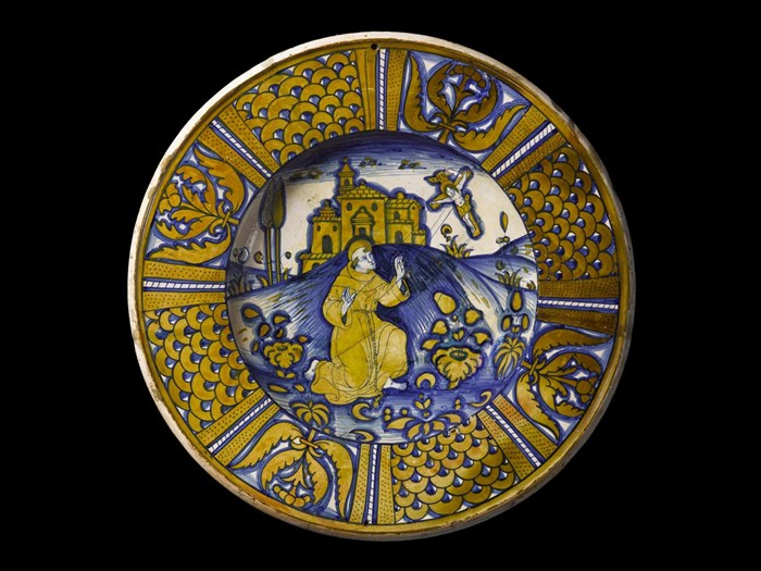 This 16th-century maiolica dish from Italy shows St Francis of Assisi.