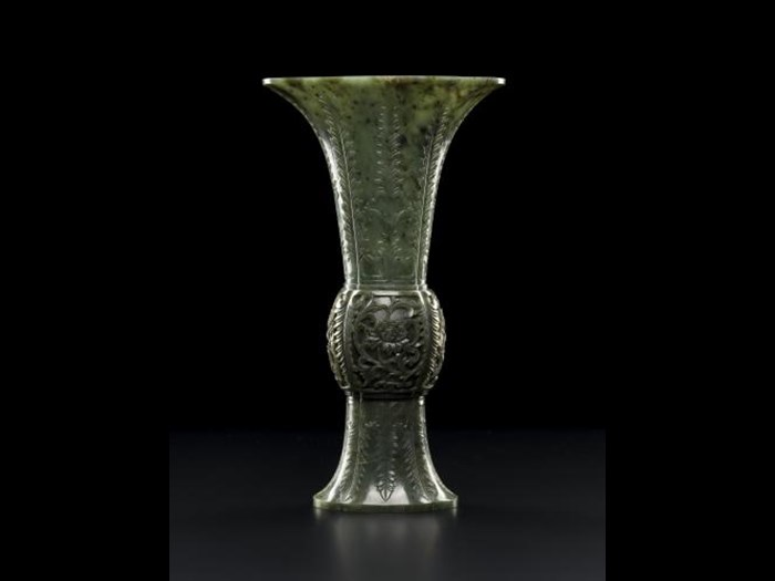 Dark green jade vase carved in the form of an ancient bronze vase: China, mid 19th century.