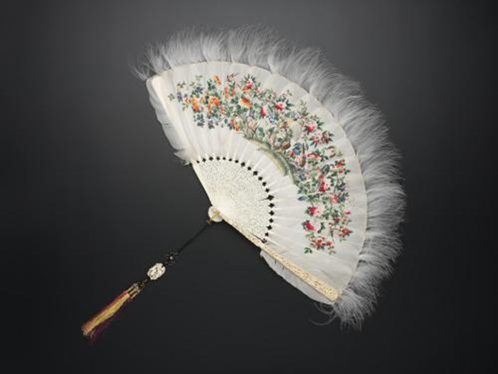 Fan with mount formed of goose feathers painted with different motifs with ivory sticks and guards and a silk tassel: China, Canton, 19th century.