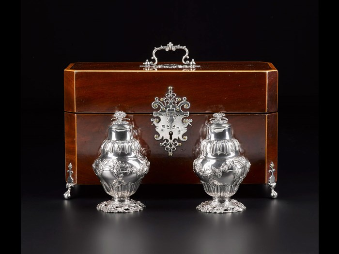 Rectangular mahogany box with silver mounts, used to contain a silver sugar bowl and pair of tea bottles: English, London, by M.I., 1762. National Museums Scotland, A.1979.502 F.