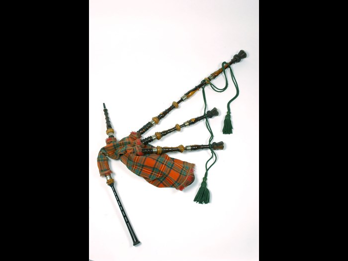 Set of Highland bagpipes of laburnum, silver and ivory mounted, with Royal Stewart tartan cover, Edinburgh c1850.