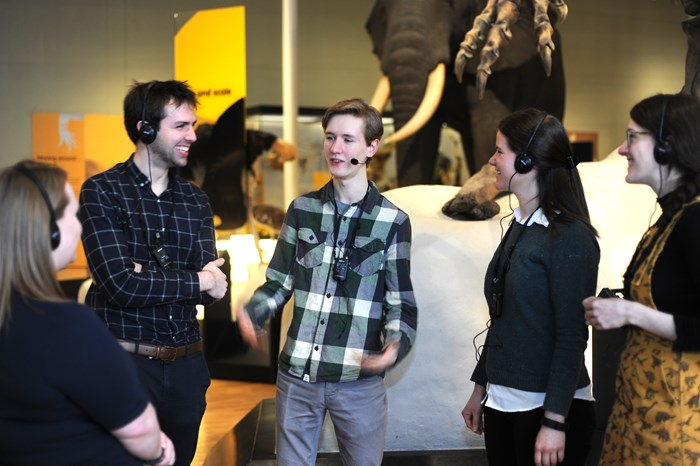Lachlan Peel, a Gaelic tour guide takes visitors around the Animal World gallery at the National Museum of Scotland.