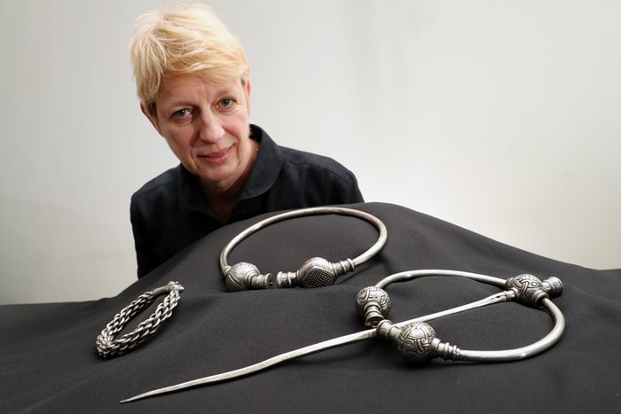 Simone Ten Hompel with silver artefacts from the 10th-century Skaill hoard. PHoto by Stewart Attwood.