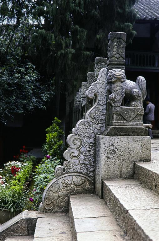 Steps up to the main entrance of Huating Temple with a stone lion sculpture, Kunming, Yunnan Province, China, 1988.