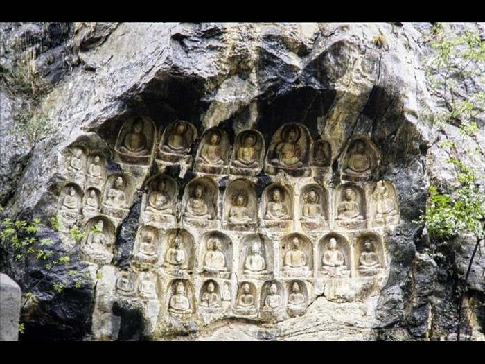 Buddhist carvings in a cliff cave, Qianfoshan, Jinan, Shandong Province, China, 1981.