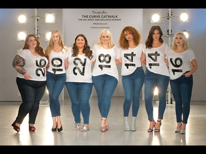 Model line-up wearing slogan t-shirts ahead of Simply Be's AW17 Curve Catwalk © Simply Be Curve Catwalk AW17