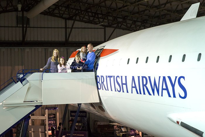 Family at the top of the boarding steps to Concorde.