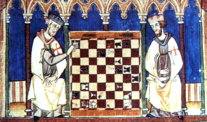 Knights Templar playing chess, from the Libro de los juegos (Book of games), or Libro de axedrez, dados e tablas, (Book of chess, dice and tables) commissioned by Alfonso X of Castile, Galicia and León, 1283. Photo from Wikimedia Commons.