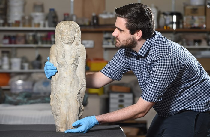 Dr Daniel Potter with a statue discovered in the collection of Montrose Museum.