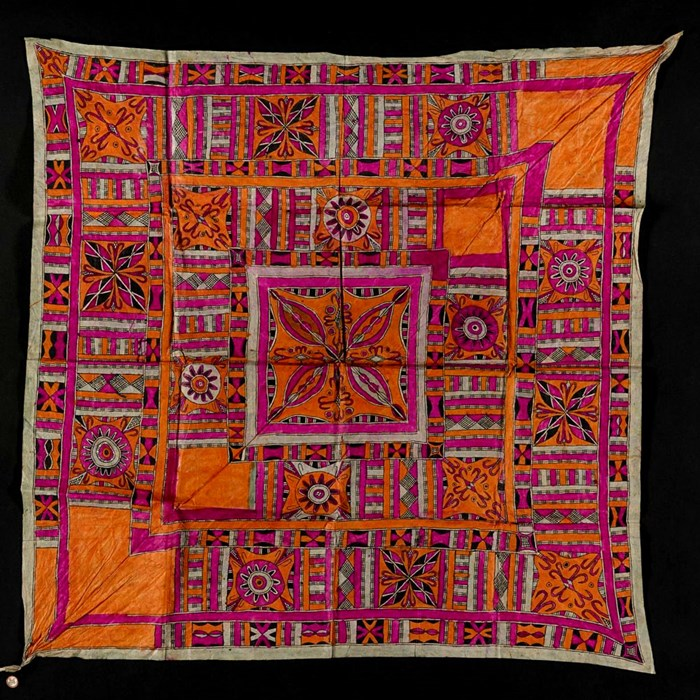 A textile with rich pink and orange pattern