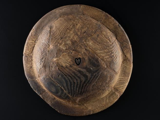 A 14th- or 15th-century wooden platter from Threave Castle, Dumfries and Galloway, bearing the heart of the Douglas family arms