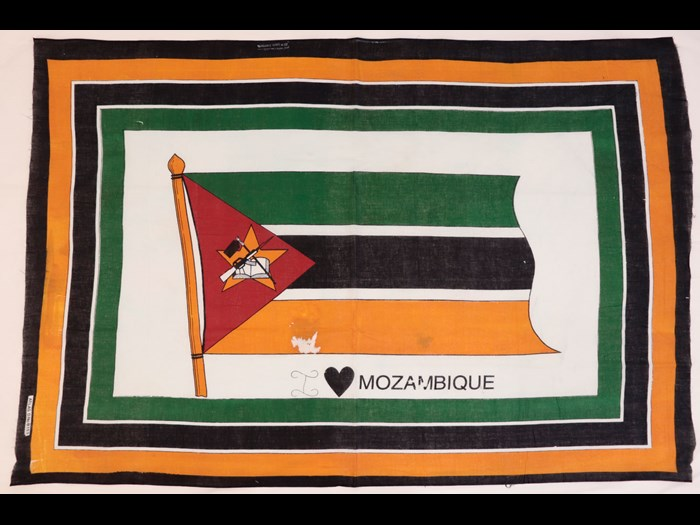 Capulana featuring the national flag of Mozambique with a border around the edge of green, black and orange with the legend 'I 'heart' Mozambique' below': Africa, Southern Africa, Mozambique, 1994-2000.
