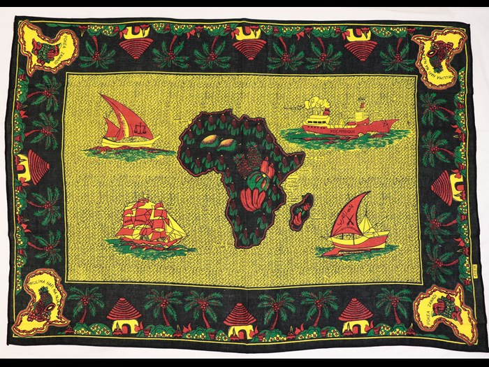 Capulana featuring a rectangular design representing Mozambican sea faring trade with a map of Africa filled with fruits in the centre: Africa, Southern Africa, Mozambique, 1994-2000.