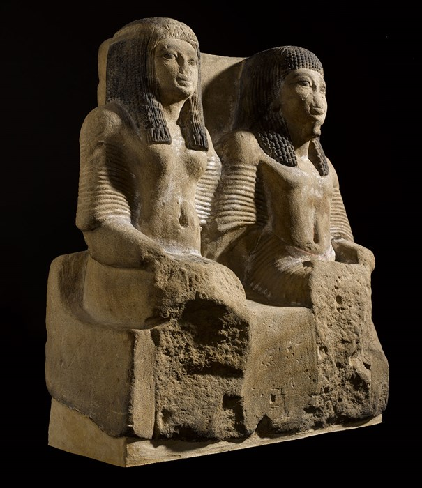 Pair statue in fine yellow sandstone of a Chief of Police (Medjay) and his wife, Sheikh Abd el-Qurna, Thebes, c.1322-1279 BC.