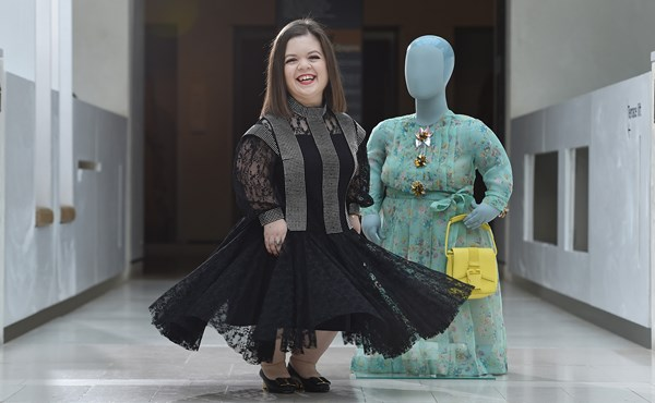 Sinéad Burke with a Christopher Kane outfit she has loaned to the exhibition, displayed on a mannequin cast from her body. Copyright Neil Hanna.