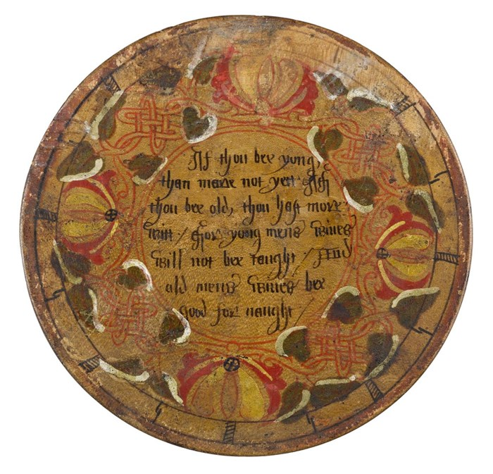 Decorated lid of box containing beechwood desert plates