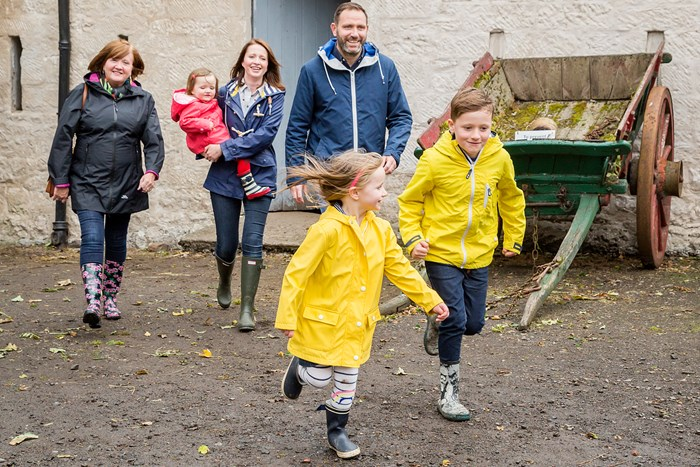 A family of 6 wearing wellies and waterproofs