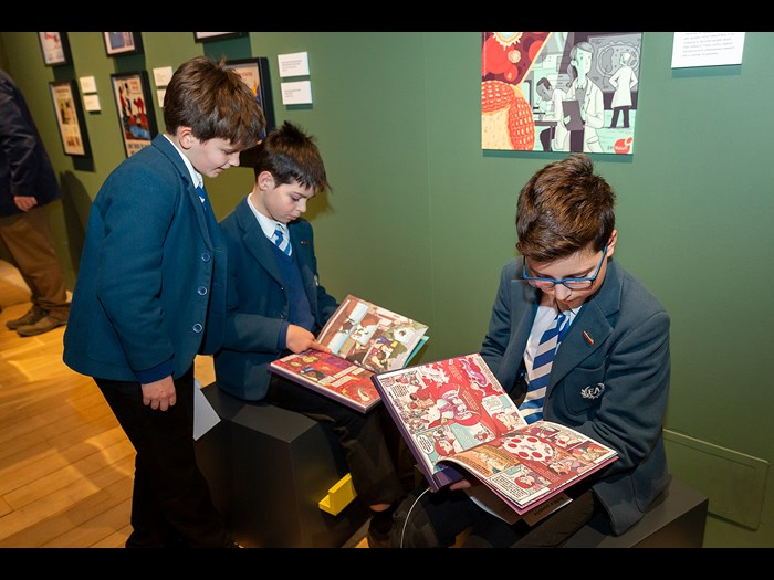 Reading comics in the Parasites exhibition © Ruth Armstrong
