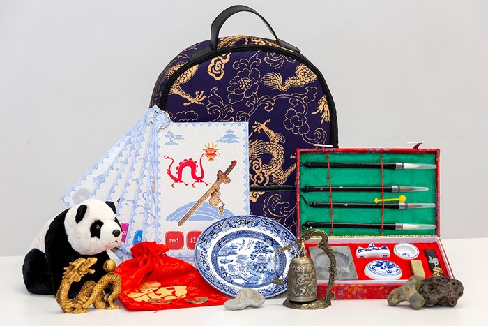Backpack with selection of Chinese objects in front
