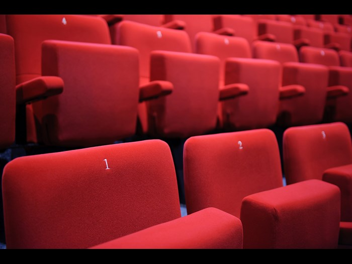 Close up of red chairs in the Auditorium