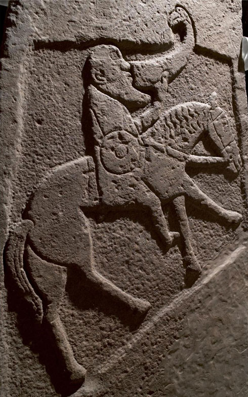 Pictish stone showing a man drinking from a horn