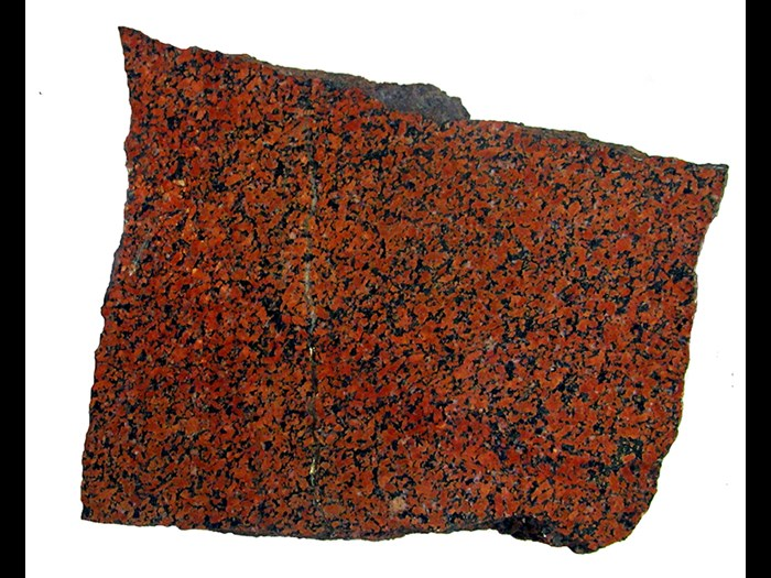 Syenite. A syenite rock can be described as a granite-like rock with silica either completely absent or present in very low quantities. Syenites are formed from igneous activity and are not common.