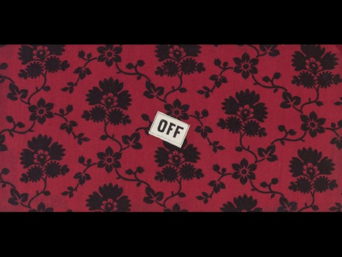 Black stylised flowers on red ground