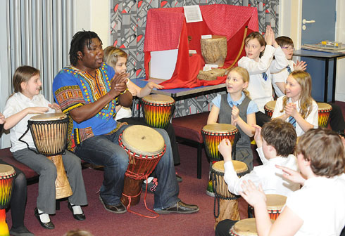 Pupils playing African music