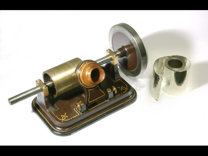 Edison foil phonograph with large flywheel, cast iron base, adjustable diaphragm and steel point for recording sound. It cost 10 guineas in 1878, and was made by the London Stereoscopic Company, England, c. 1878.
