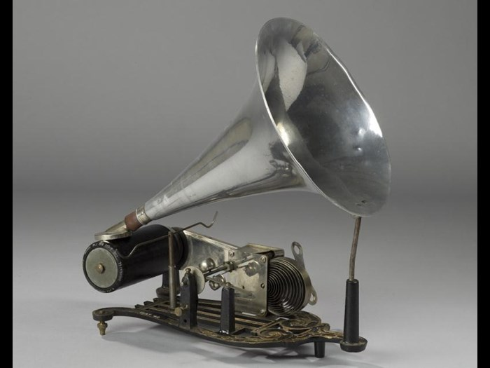 Skeleton phonograph with cast iron base with zinc cylinder driven by a cord from a small clockwork mechanism with governor, and an aluminium horn with reproducer marked Skylark.