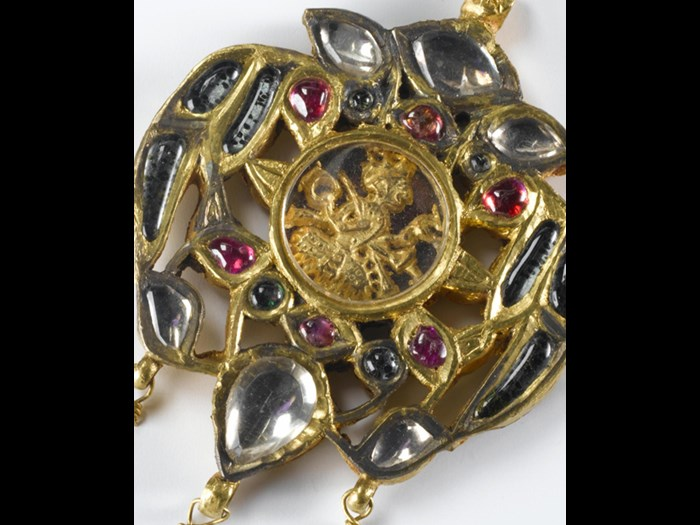 Pendant of gold with rubies and glass stones; in the centre the depiction of deity under a rock crystal: Northern India, probably Punjab, 19th century, formerly in the possession of Maharaja Duleep Singh