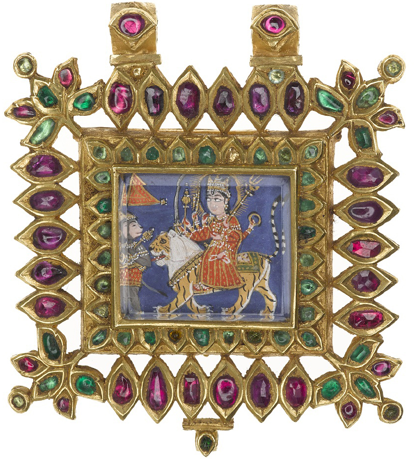 Gold pendant with rubies and emeralds; in the centre a depiction of the Hindu goddess Devi seated on a lion and preceded by the god Hanuman: Northern India, probably Rajasthan, 1800-1850, formerly in the possession of Maharaja Duleep Singh.