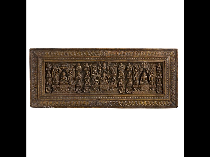 Wooden sutra cover with Prajnaparamita (at centre), Shakyamuni Buddha (at right), and Vairochana (at left), and bodhisattvas and deities. 15th-16th century. Acquired by Lt. Frederick 'Eric' Marsham Bailey. A.1910.192