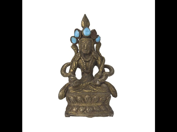 Statue of a seated bodhisattva, made of brass and turquoise. 19th century. Acquired by Rev. J.W. Innes Wright. A.1897.319.8