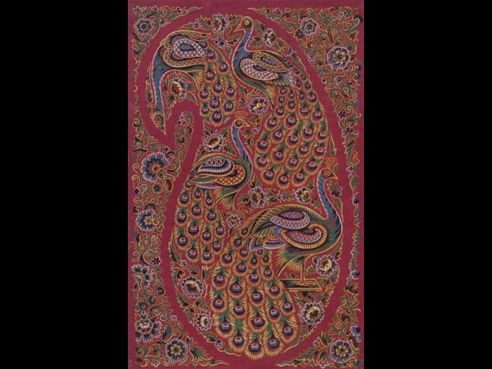 Multi-coloured paisley shape with peacocks inside