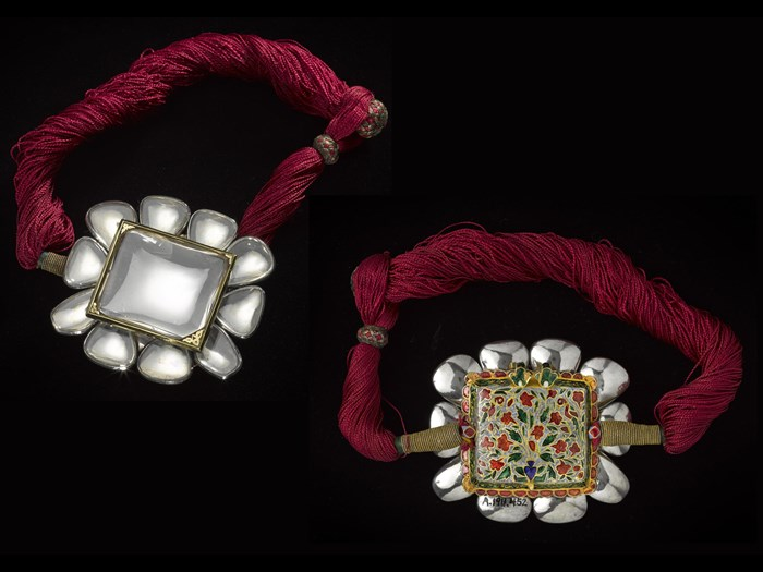 Front and rear view of armlet composed of a central rock crystal and ten smaller stones set in silver, the back decorated with Jaipur enamel on gold: Northern India, 1800-1850.