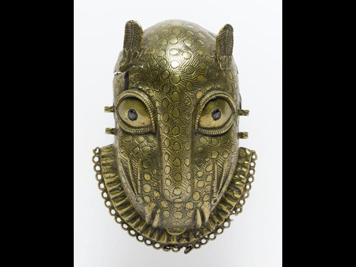 19th century hip ornament in the form of a leopard's head of cast brass inlaid with iron, worn on the belt at the hip by the Oba or by chiefs of high rank.