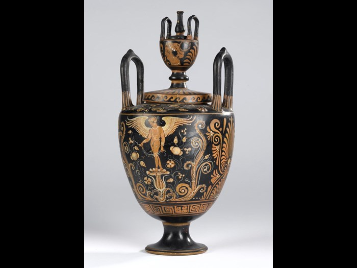 Lebes gamikos of pottery decorated in red figure style with two standing figures of Eros, palmettes, key meander and scrollwork.