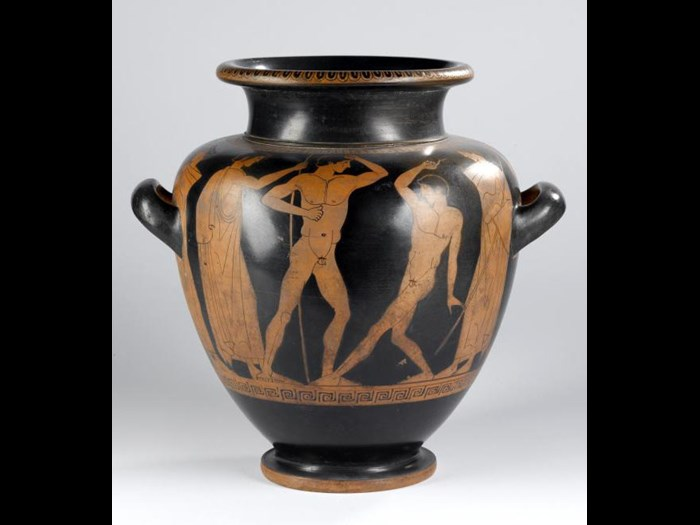 Earthenware stamnos with red figure decoration of wrestlers, boxers, and figures with staffs.
