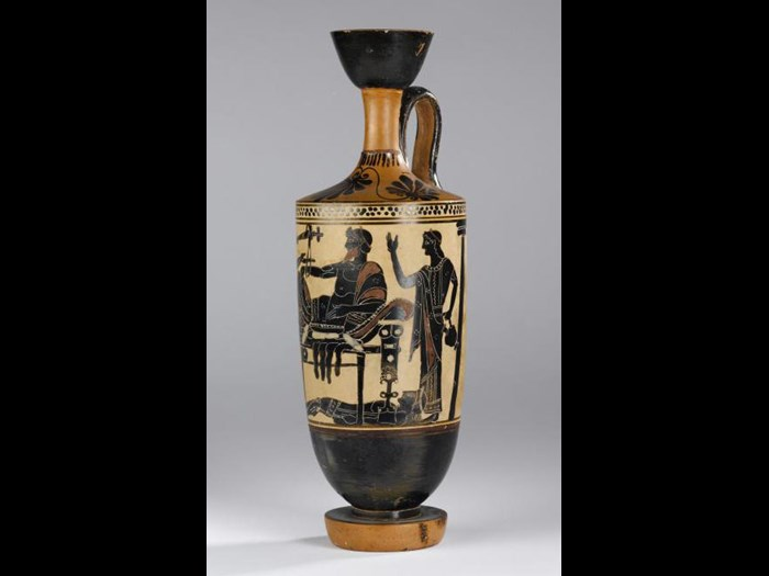Lekythos of pottery decorated in black figure style on a white ground with a scene representing Achilles delivering up the body of Hector to Priam.