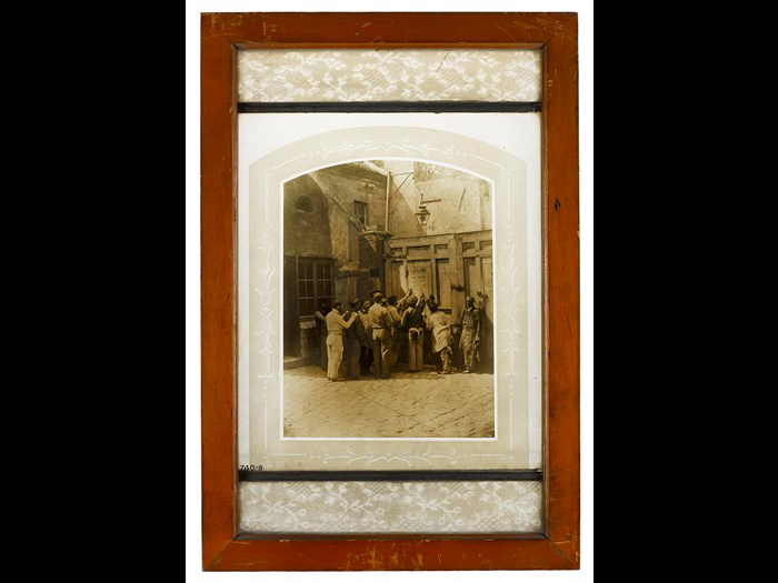 Photograph burnt in on glass, a group of workmen, Paris 1858.