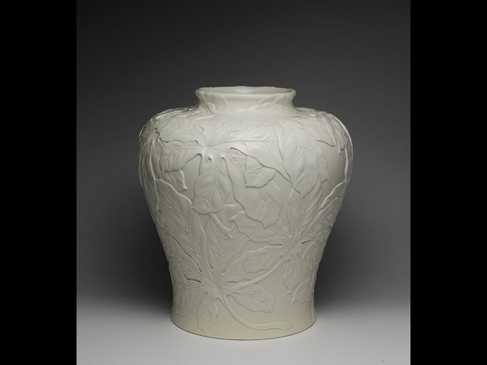 Large stoneware vase decorated in low relief with foliage, possibly Suwa Sozan design, by Kinkozan, c.1900.